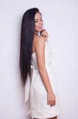 young beautiful caucasian brunette in gorgeous dress, motion shot