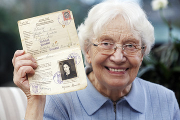 Senior women showing her old temporary passport