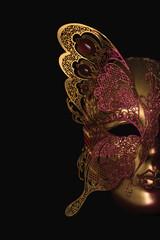 Gold tone Venecian carnival Mask black background