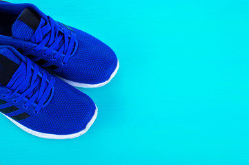 Blue Sport shoes. Running shoes on blue background
