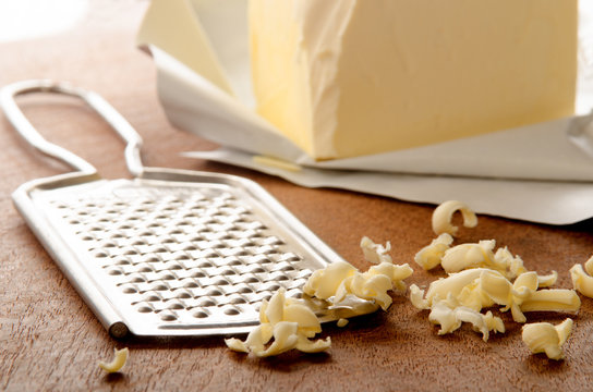 grated butter on wooden board