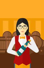 Waitress holding bottle of wine.