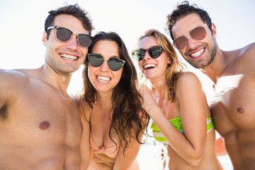 Portrait of smiling friends on the beach
