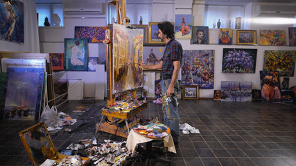 In the process of creating a masterpiece. A professional artist working in his studio.