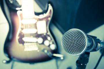 microphone, blur guitar background.