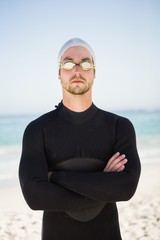 Handsome man wearing swimming cap and goggles