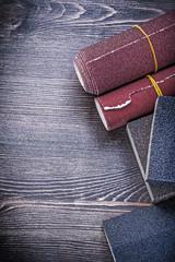 Rough abrasive paper sponges on vintage wood board construction