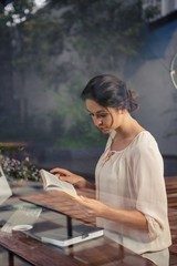 Businesswoman reading a book at desk