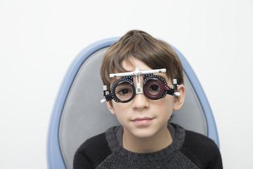 Boy wearing eye test equipment