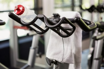 Bottle of water and napkin on exercise bike