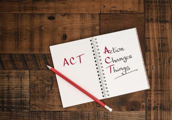 ACT - concept - hand-written in notebook