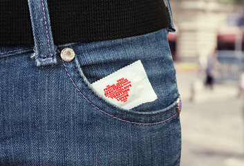 Condom in the pocket of blue jeans