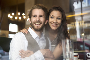 Happy young couple in a cafe