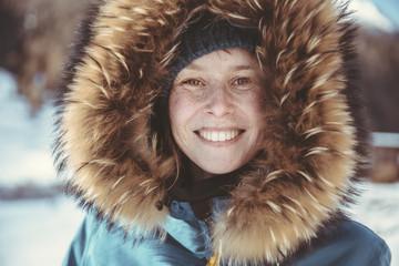 Portrait of happy woman with fur hood