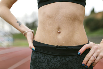 Athlete woman, abdominal muscles