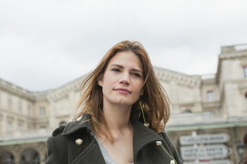 France, Paris, portrait of young woman with ear phone