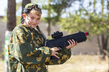 Boy with a gun playing laser tag