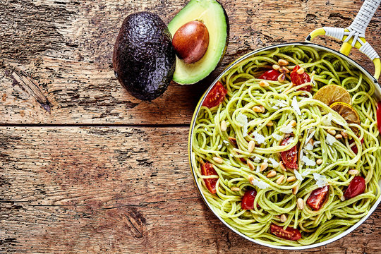 Exotic Italian spaghetti pasta with avocado pear