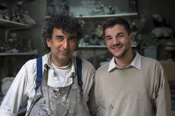 Gremany, Munich, Portrait of two art foundry workers