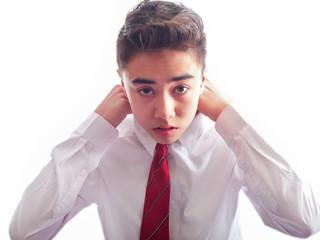 teenage boy tying a tie