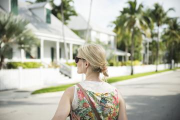 USA, Florida, Key West, woman on street looking around