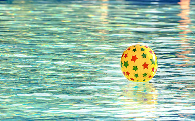 Inflatable ball floating in swimming pool, With place for your text
