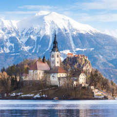 Panoramic view of Julian Alps, Lake Bled with St. Marys Church of the Assumption on the small island; Bled, Slovenia, Europe.