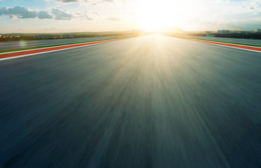 Wall Mural - Motion blurred racetrack,evening