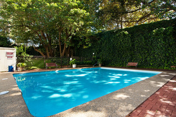 Lovely pool in the garden in the park.