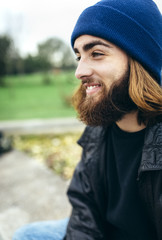 Portrait of smiling young man wearing blue woolly hat