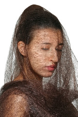 closeup portrait of lady in veil with closed eyes