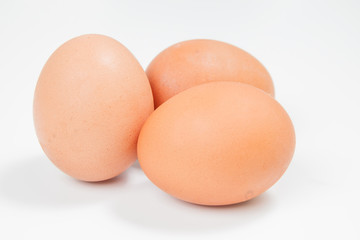 Three chicken eggs on a white background