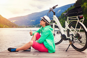 woman with e-bike resting beside a beautiful lake-e-power 18