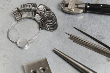 Tools set of jewellery. Jewelry workplace on metal background with copy space for text. Top view.