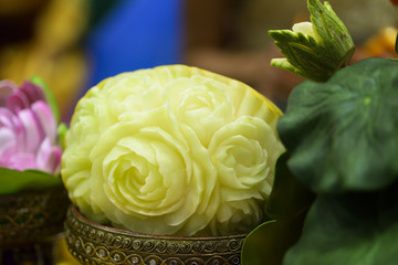 yellow melon carved in the shape of roses