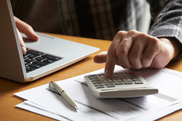 Man Working Out Household Finances