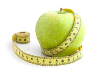 Green apple and measuring tape. Diet concept.