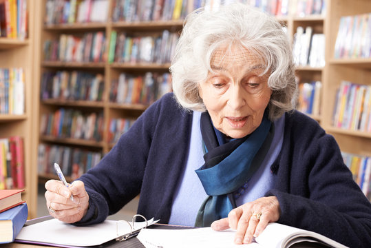 Senior Woman Studying In Library
