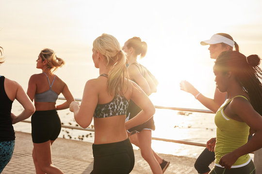 Group of fit young women running together