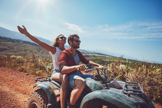 Young couple enjoying quad bike ride