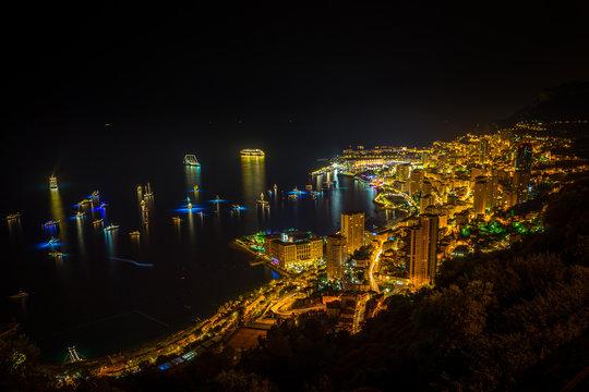Monaco skyline by night with many boats