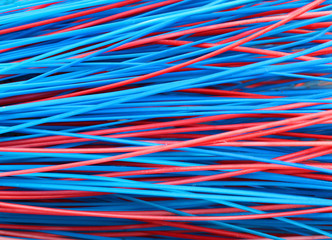 Colorful red and blue stems of plastic broom closeup