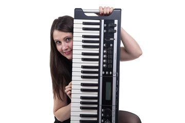 Smiling woman with synthesizer