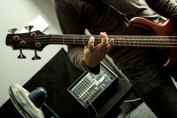 Playing the Bass in a rehearsal room.