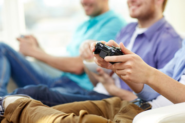 close up of friends playing video games at home