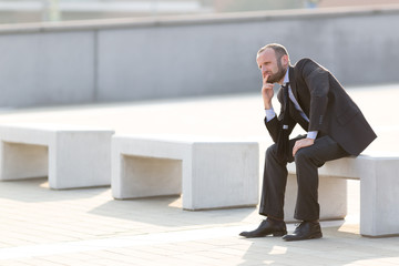 Frustrated businessman outdoor in the city