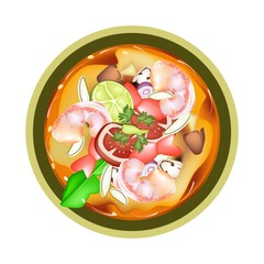 Tom Yum Goong or Thai Spicy Sour Soup with Shrimps