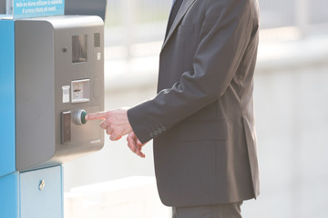 Businessman and a parking ticket pay machine