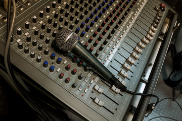 microphone on sound mixer background.