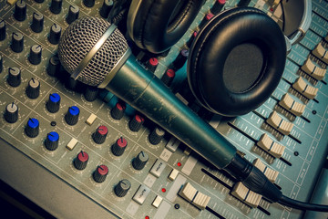 microphone ,headphone on sound mixer background.